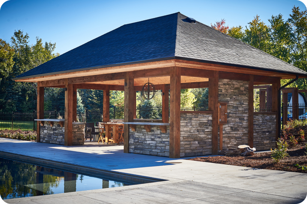Stone and wood pergola - The Difference Between An Arbor, Pergola, Cabana, And Pavilion